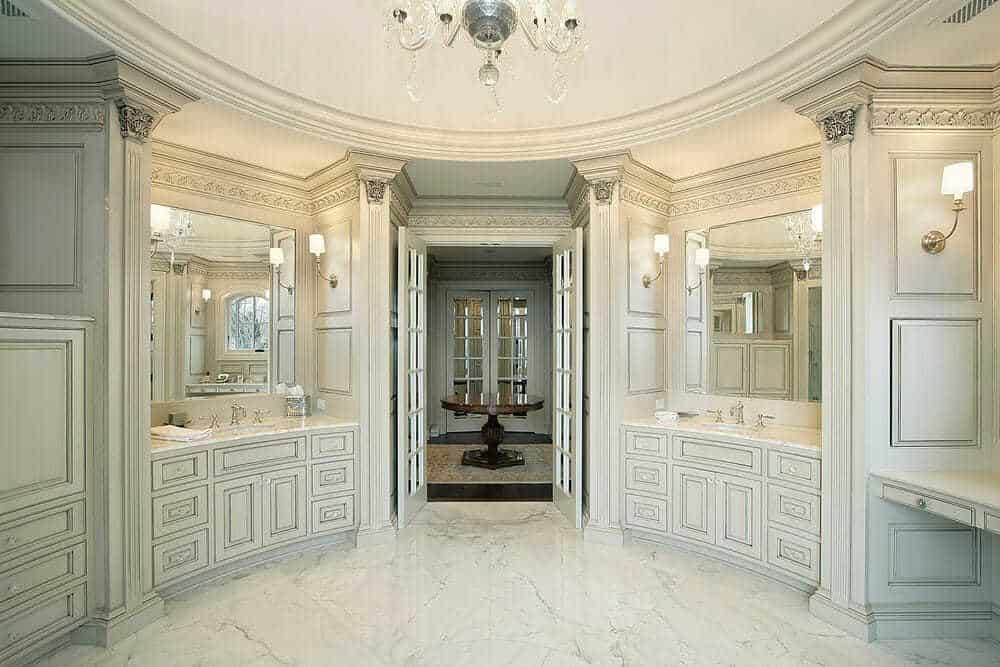 Words do not do this luxury bathroom justice. The attention to deal in the cabinetry and marble flooring is over the top.