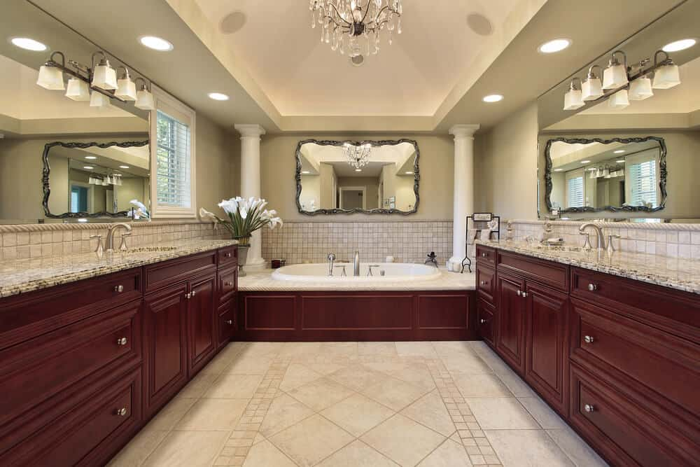 Classic symmetry can still have a lot of impact. We love the use of the tile that wraps around the sinks and tub.