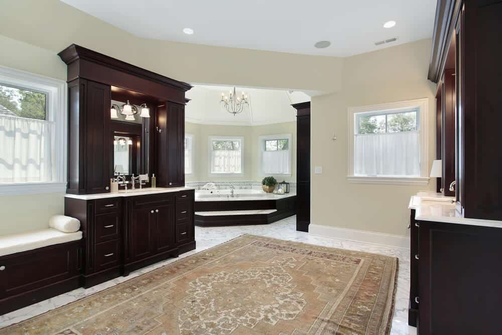 Make your bathroom a little feel less cold by adding large rug in the middle. They help with slip but also add to the overall look and feel.