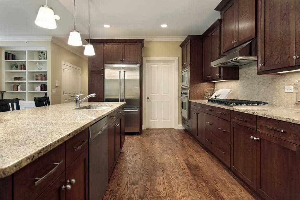 These wooden cabinets are very traditional in color and style, but silver appliances and cabinet handles help to add a mix of modern kitchen style to this home.