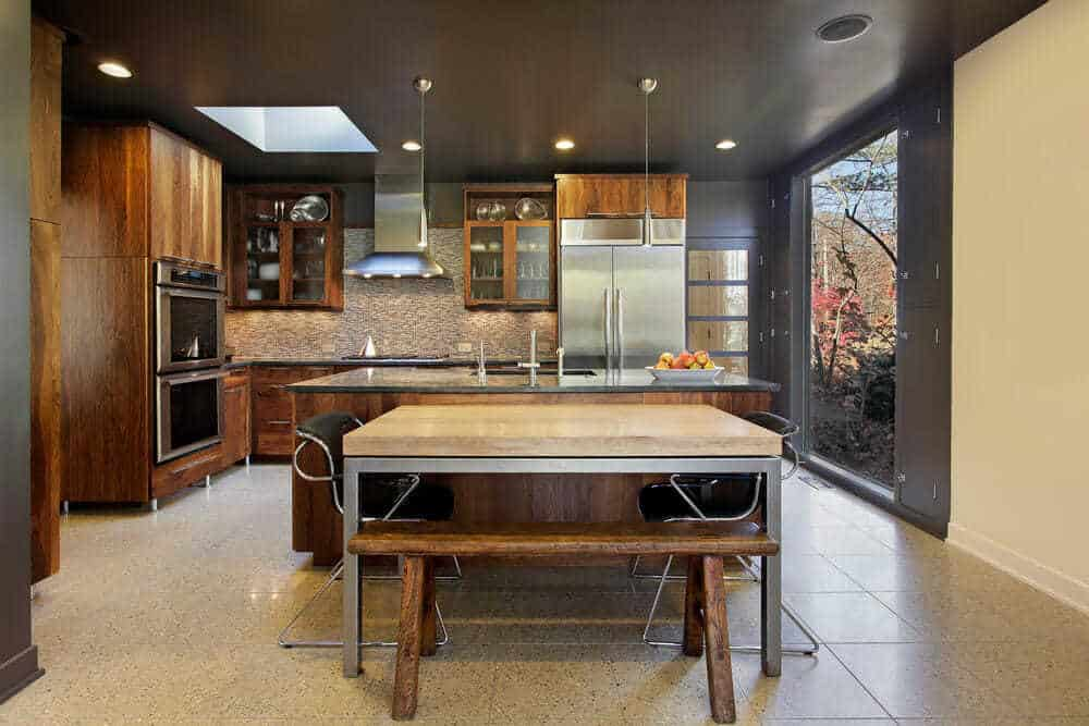 Modern kitchen in suburban home with large picture window
