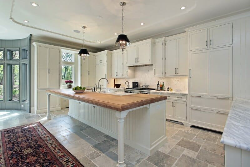 Kitchen with white cabinetry and eating area