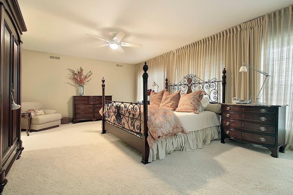 Master bedroom in condominium with dark wood furniture