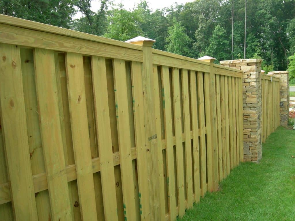 Shadow box fence designs create a unique look by using shadows to create more depth when viewing.