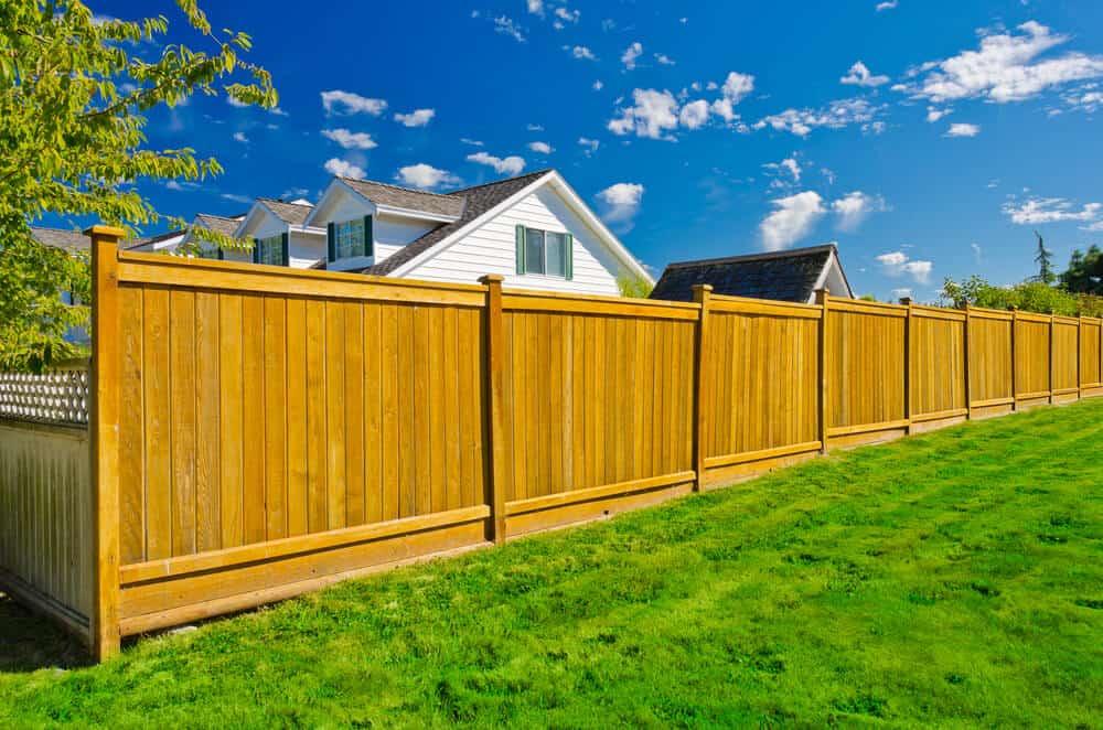 Cedar fence panels with a 4x4 cedar fence post and caps.