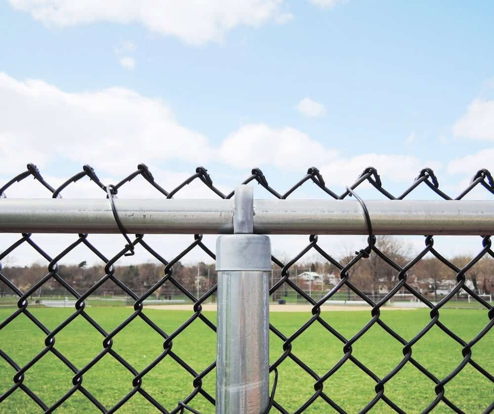 Black chain link fence is a cheap way to make this industrial fencing look more appealing and is an nice upgrade from standard chainlink fence.