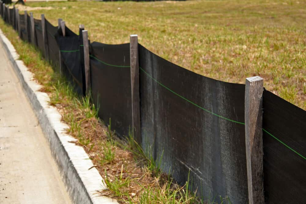 Slit of filter fence helps protect nearby water by creating a barrier to keep unwanted chemicals and sediment contained.