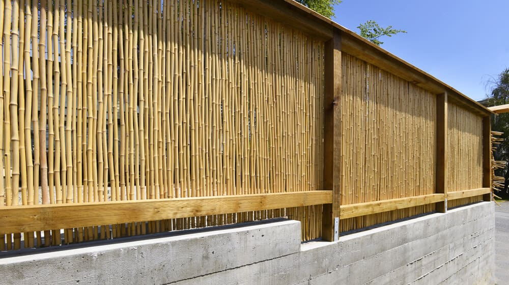 The mix of milled wood for enhanced structure compliments this unique bamboo fence.