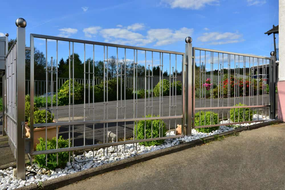 Steal fence posts support this modern metal fence.