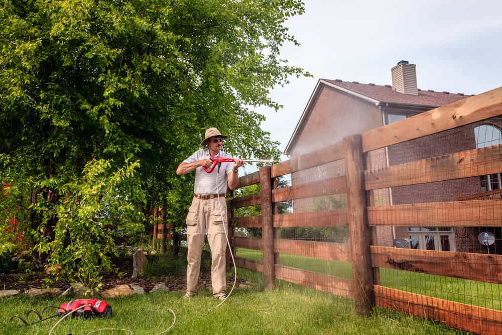 Most people don't know you can simply pressure wash wooden fence posts and boards to get them looking new again.
