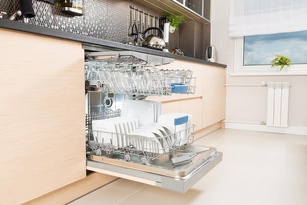 Add a wooden panel to the front of your dishwasher so that it seamlessly blends in with the rest of your kitchen cabinets.