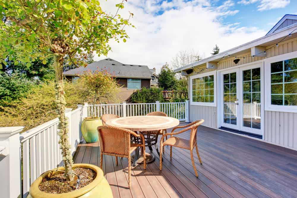 This little white fence encloses the patio area nicely and ties in well with the white trim on the home.