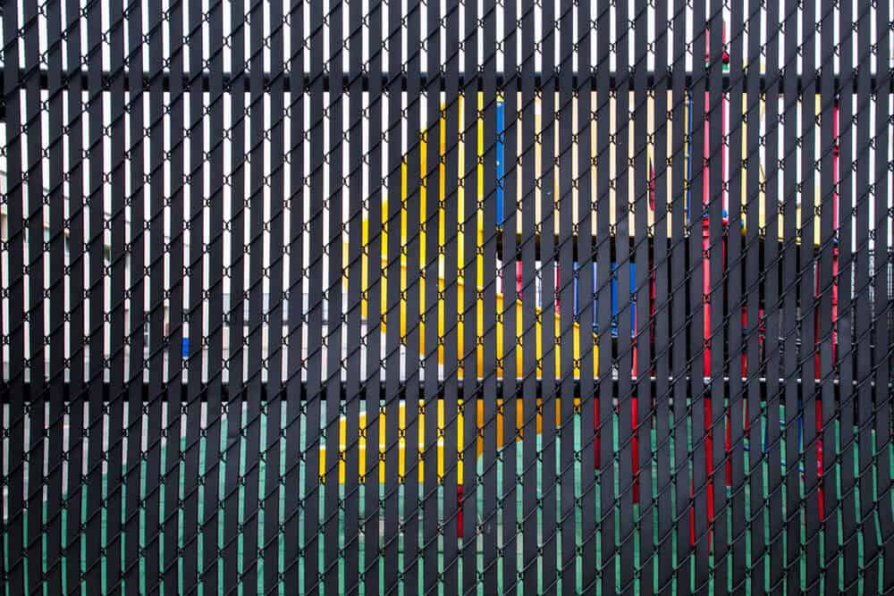 Chain link fence parts, like the slats, can be added as a part of your chain link fence installation.