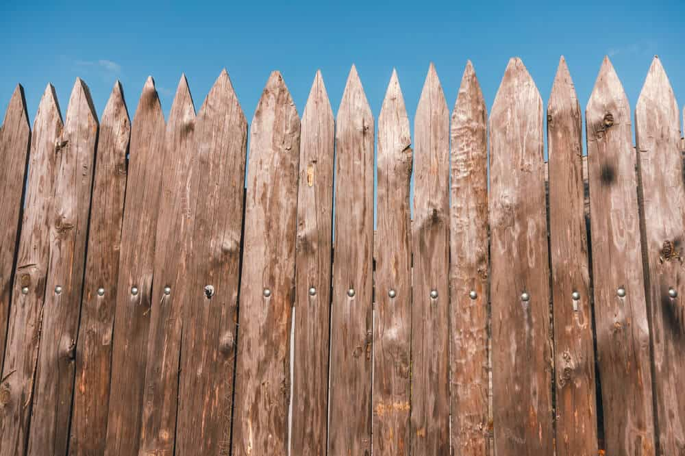 Here you see a more common look to the stockade fence where not all boards are uniform.