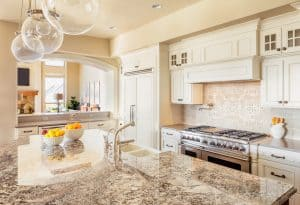 The granite slab here pairs with white cabinets to create a pristine, old-fashioned design. Of course, the stainless steel appliances step things up a little.