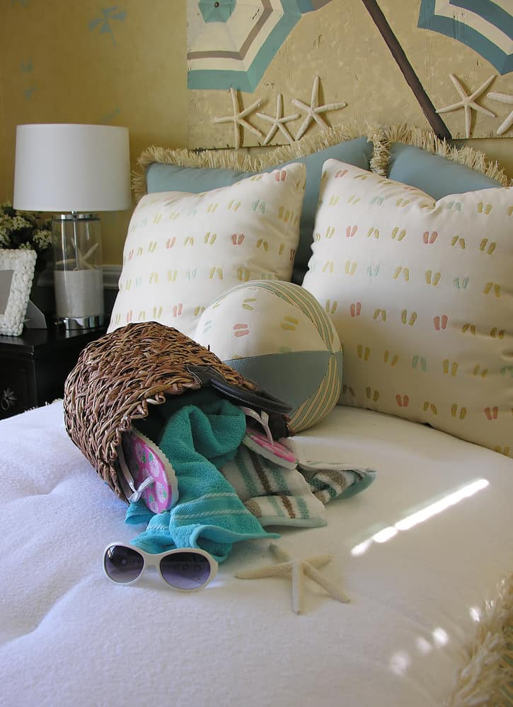 Here there's a little bit of a beach theme to the walls with the sand color but the starfish, flip flop pillows and cute lamp complete the look. It's beachy without being too over the top.