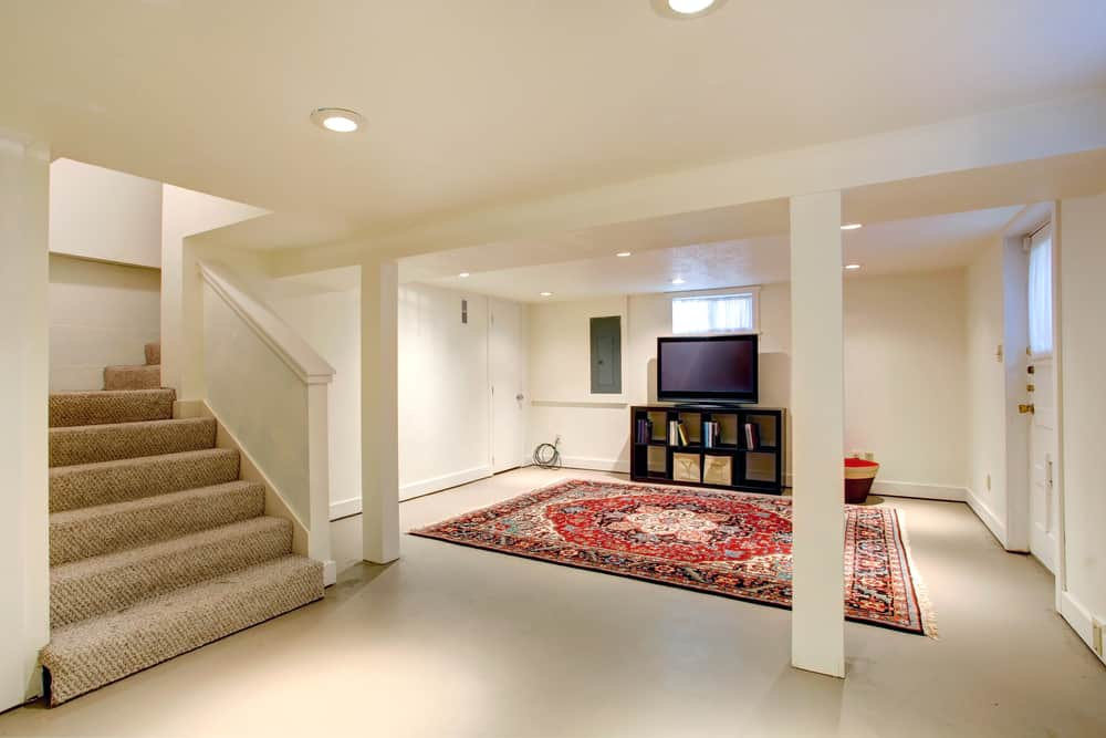 This floor is actually solid and completely smooth. Some type of tile or linoleum can be a great option because it does keep the area smooth and you can dress it up with rugs or anything you like.