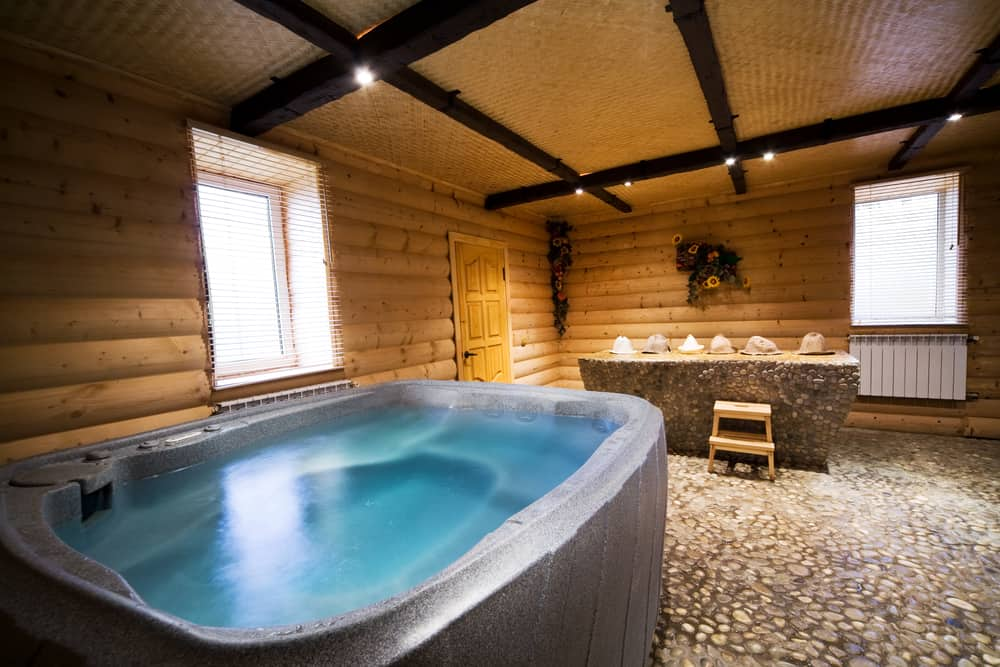 This large cabin actually has it's own sauna area and sitting area to go along with the hot tub. There's plenty of space in this room and it could even be a full room attached to the house so there's no need to go outside at all.