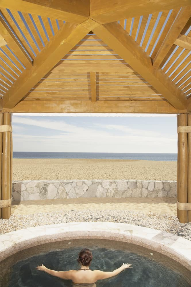 With this gazebo you get a little bit of opening all the way to the sky, but enough of a protection to keep you out of the elements. The oversized bamboo 'legs' definitely make it feel more beachy and tropical as well.