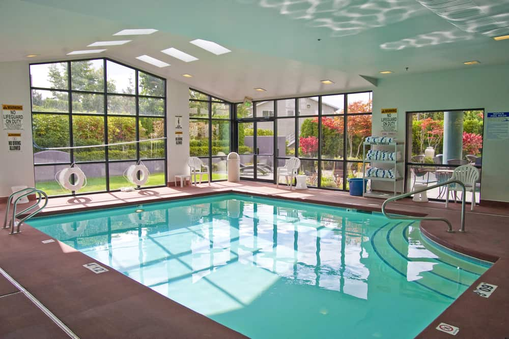 This pool is pretty standard for an indoor pool, but it does have a nice staircase to get in. You've got a large size and an easy entrance or exit in an accented corner.