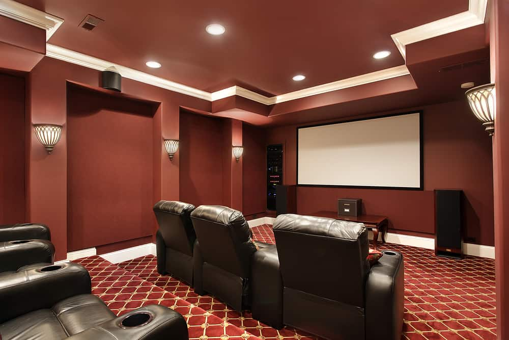 In this room you have levels of seats and you have individual recliners with cupholders for everyone. The screen is large and the controls and speakers are great as well.