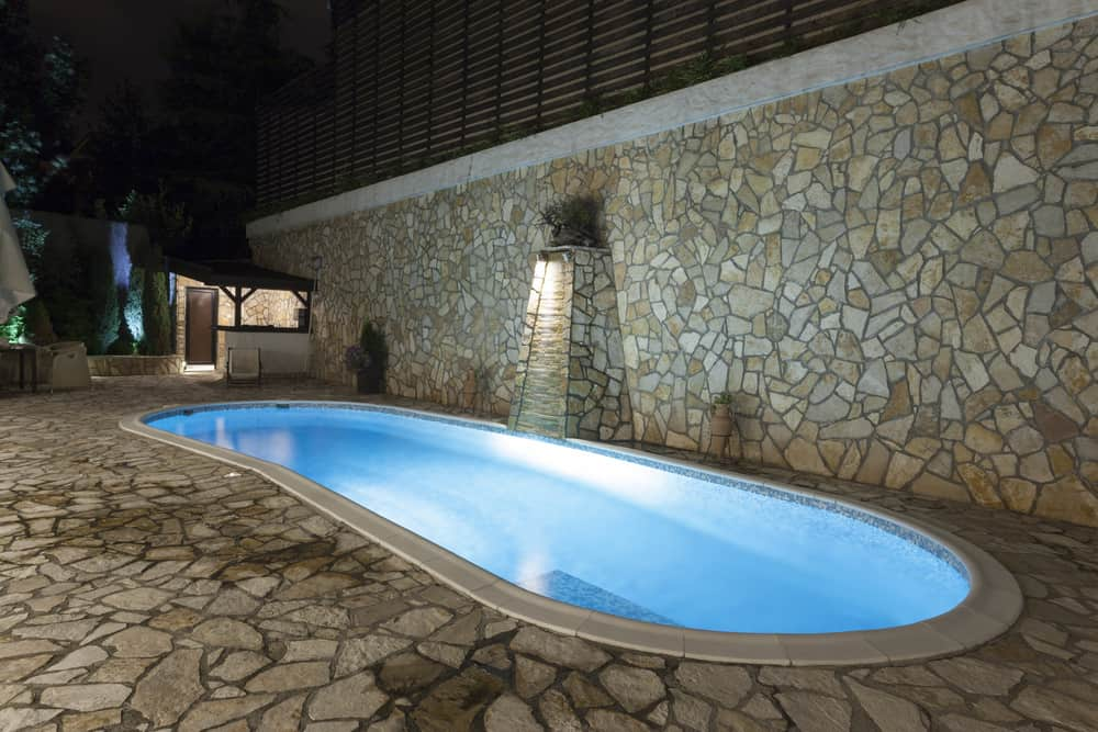 An oblong pool can let you get a few laps in even with a smaller square footage pool. It's definitely a unique look too so you get two things all at the same time.