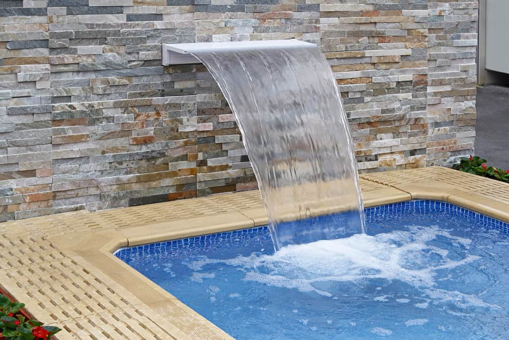 This small pool has its very own waterfall and who doesn't love that? You're definitely going to have some fun here and it's small enough to fit wherever you want.