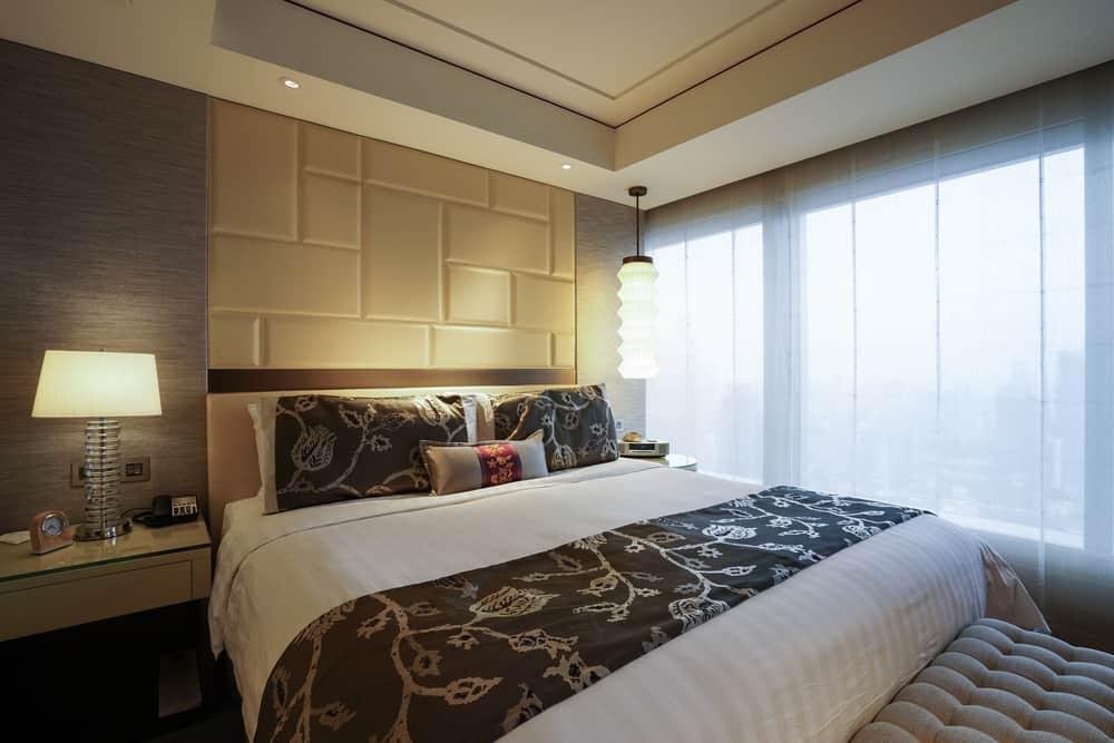 A king size mattress inside a hotel.