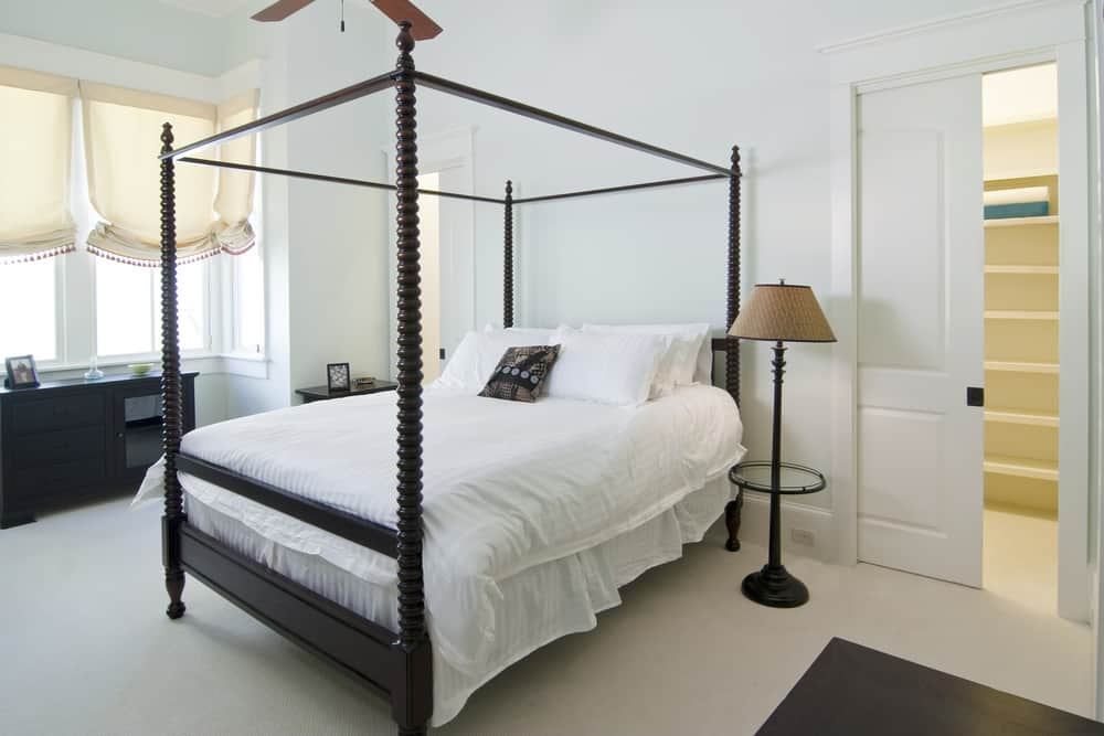 A standard four-poster bed has poles that come out of each corner